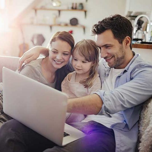 Family looking at a computer together